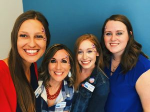 the women of Robbins Insurance Group with fireworks face paint!